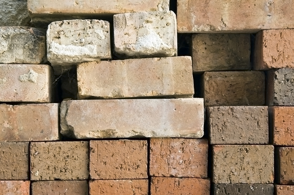 Bricks stacked against a wall