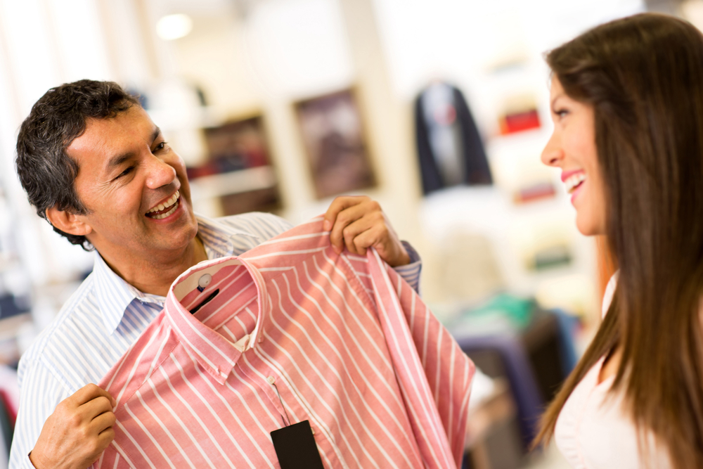 Happy couple in a store shopping for shirts