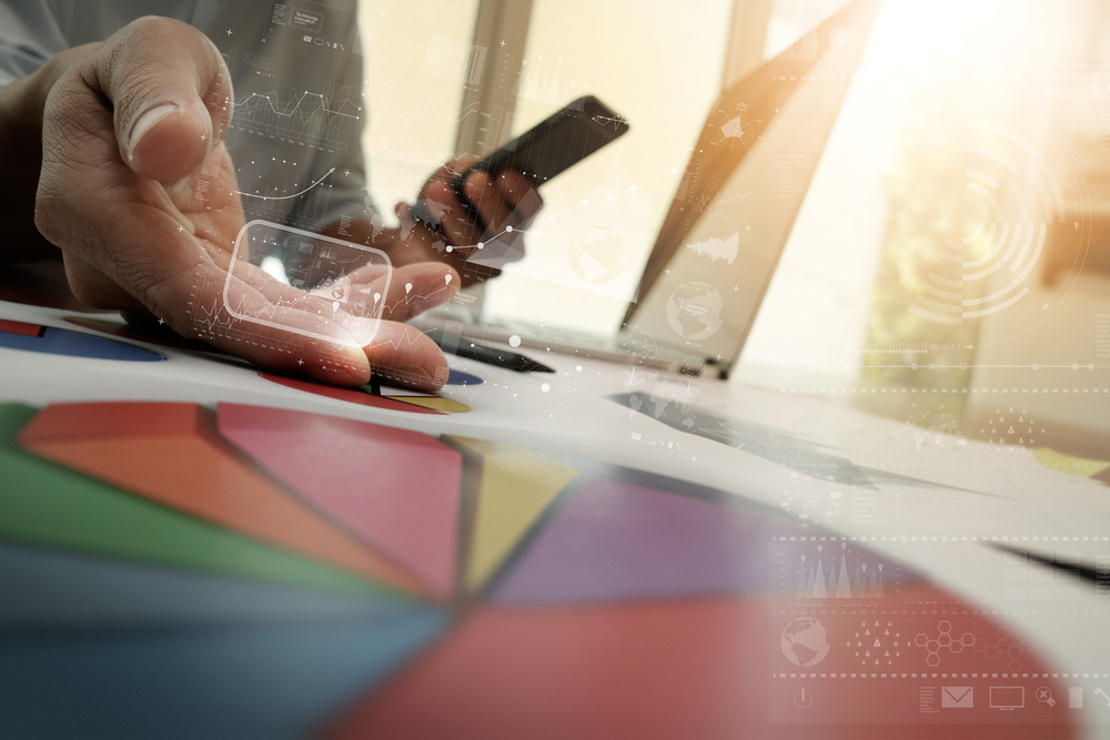 businessman hand working with new modern computer and business strategy digital layer as concept