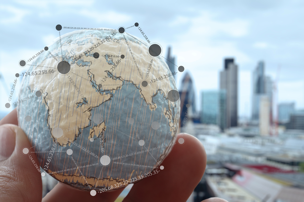 close up of businessman hand showing texture the world with digital social media network diagram concept Elements of this image furnished by NASA london city background